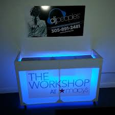 photo booth rental miami white acrylic dj booth rental with led lighting and logo branding