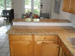 giallo fiorito granite with oak cabinets new venetian gold granite welcome to fire place carolina