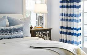 light blue striped curtains white padded headboard with blue striped curtains transitional