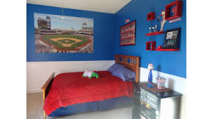 boys bedroom with minimalist furniture and fun decorations view