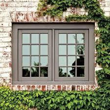 gable detail with brick rowlock around window new house