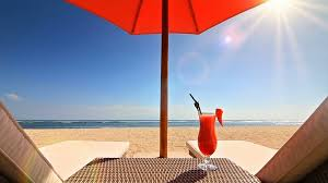 Clip On Umbrellas For Beach Chairs Relax On The Beach With Two Lounge Chairs An Umbrella A Table
