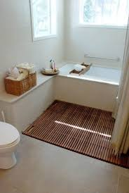 ceramic wood tile bathroom white bathtub built in storage shelves