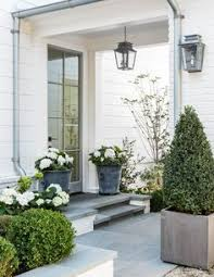 Front Door Planters by Frame Your Entrance With Some Beautiful Boxwood Topiary Opt For