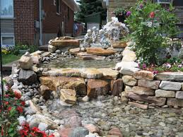 garden natural stone waterfall pond design with kid statues for