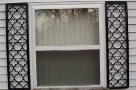 exterior wooden window shutters wrought iron exterior shutters