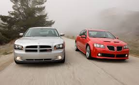 2008 pontiac g8 gt vs 2008 dodge charger r t photo 200176 s original jpg
