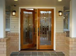 modern home entry way door with brown stained wooden swing glass