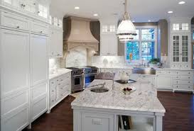 Kitchen White Cabinets Thunder White Granite Pairs Well With The Pendant Lighting And