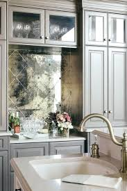 mirrored backsplash pictures smoked kitchen white cabinets with