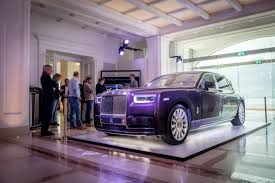 purple rolls royce media drives rolls royce