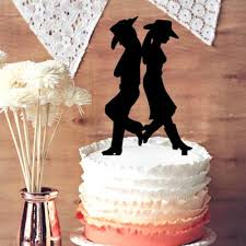 rustic cowboy and cowgirl wedding cake topper groom and bride