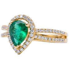 gold emerald engagement rings pear shape emerald yellow gold halo engagement ring for