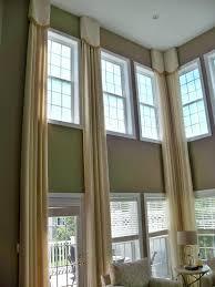 elegant stationary panels custom designed for a great room with elegant stationary panels custom designed for a great room with two story windows dresses the windows