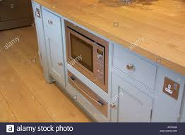 close up of kitchen unit with built in microwave oven and warming