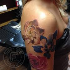 realistic flower tattoo by francisco sanchez tattoos