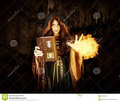 halloween witch holding magical book with runes making magic stock