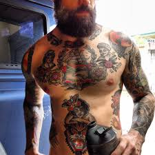 a with a beard and tattoos especially