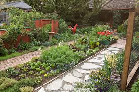 ornamental edible garden mixed bed of herbs vegetables and