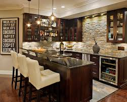 uba tuba granite home bar traditional with dark wood cabinets