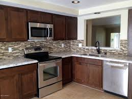trasitional kitchen remodel in scottsdale with matte black kitchen arts crafts style kitchen design with solid oak wood finish cabinet in scottsdale mosaic