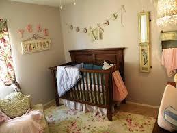 baby gray nursery ideas pink bows beige chair black crystal