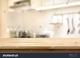 kitchen island used wood table top as kitchen island stock photo 411197995 shutterstock