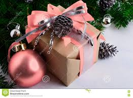christmas gift box with pink ribbon and silver beads stock photo