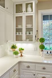 this classic white kitchen with fresh accents and open glass
