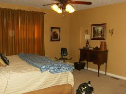 what is the best color for bedroom with classy orange wall and
