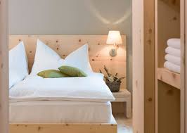 scenic white cover single bed added oak wood paneling ideas for