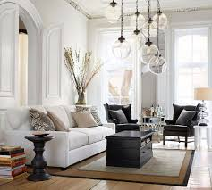 Pottery Barn Living Room Ideas by Pottery Barn White Sofa Black Leather Wing Back Chairs Sisal