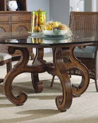 curving brown wooden legs with round glass top feat rattan dining