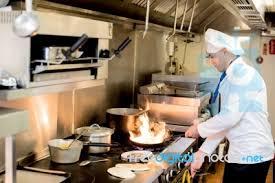 cuisine chef chef preparing cuisine in hotel kitchen stock photo royalty free