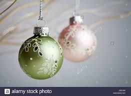beautiful baubles hanging from white branches stock