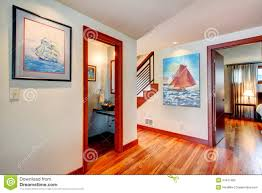 Open Bedroom Bathroom Design by Ivory Hallway With Hardwood Floor Iron Railings Stairs Open To