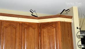 Install Crown Molding On Kitchen Cabinets Adding Height To The Kitchen Cabinets Tempting Thyme