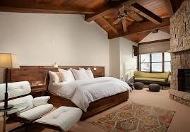 rustic chic bedroom green fur rug on wooden floor white wooden