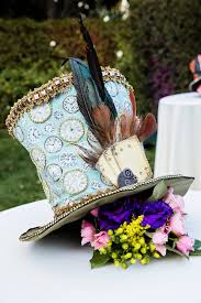 a quirky mad hatter floral centerpiece suitable for a tea party at