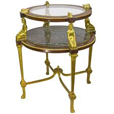 egyptian revival gilt bronze figural two tier marble and glass