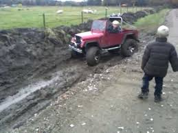 small jeep for kids two kids drive a 1 2 size jeep through mud youtube