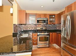kitchen design rockville md craftsman kitchen with simple granite counters u0026 glass panel in