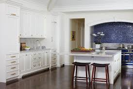 White And Blue Kitchen - white and blue kitchen with arched cooking alcove transitional