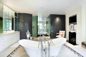 white bathtub on white ceramic flooring tile also cabinet and