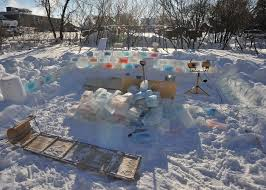 backyard turned colorful fort made of blocks of ice wave avenue