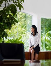 business woman gazing out window trees dreamstime m jpg
