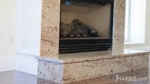 brown granite fireplace surround