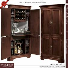Corner Cabinet With Doors by 695111 Howard Miller Wine Bar Corner Cabinet In Cherry Finish Norcross