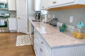 kitchen cabinets with countertops arctic ivory quartz