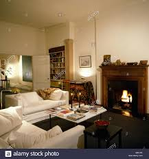 Contemporary Livingroom Fire Lit In Fireplace Of Contemporary Livingroom With White Sofas